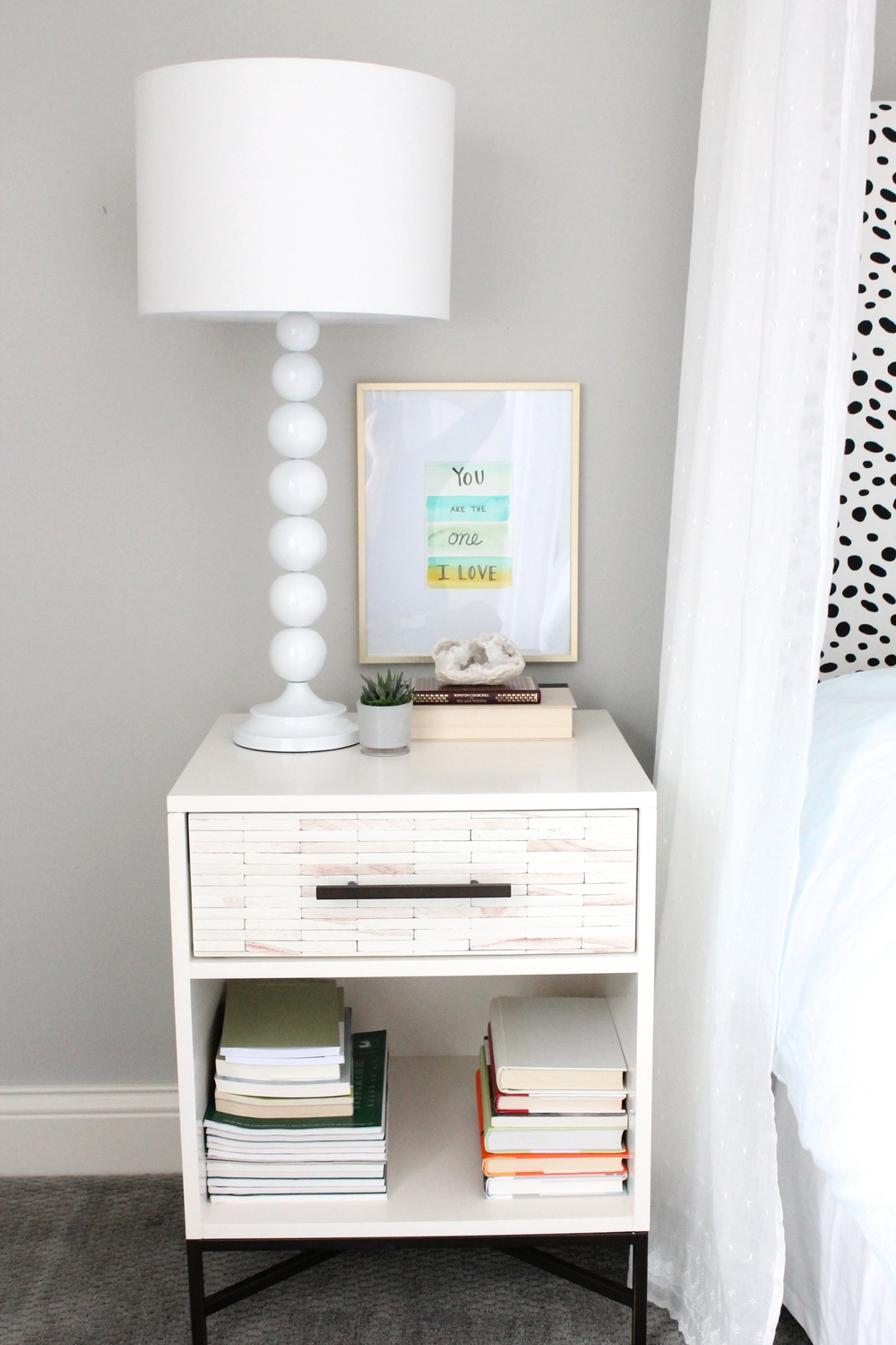 West Elm Nightstand with watercolor artwork in a gold frame. Lovely master bedroom.