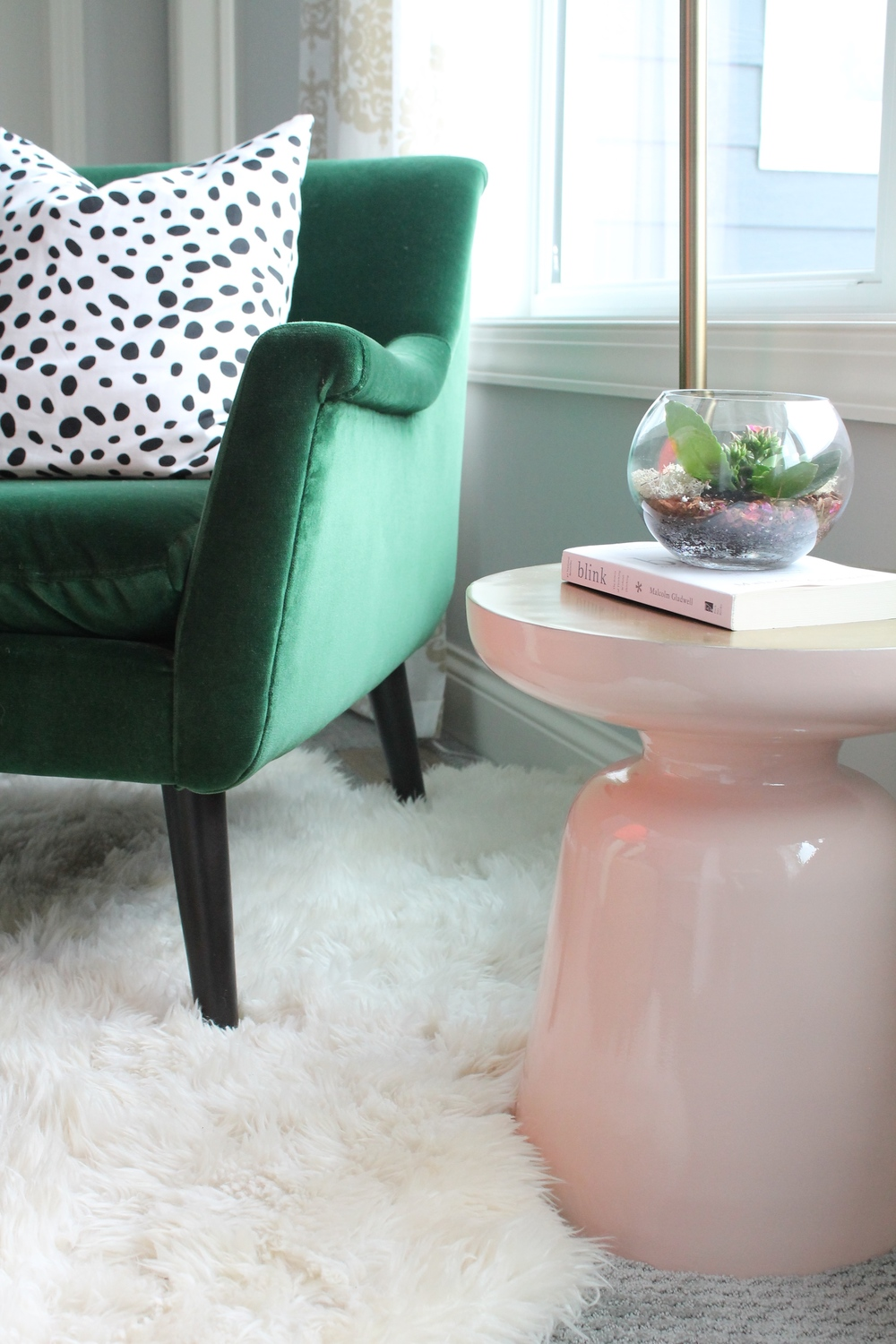 This pink and gold martini table from West Elm makes the perfect perch for a book or drink in this lovely master bedroom reading nook.