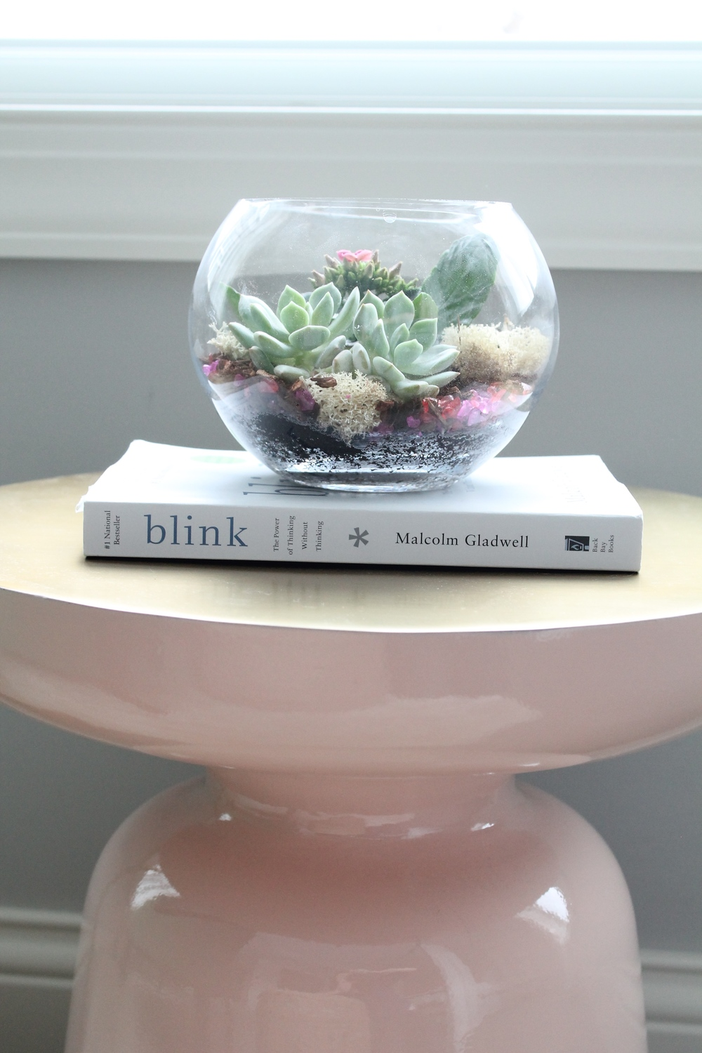 Pink and gold side table/martini table from West Elm. So lovely with the succulents on top.