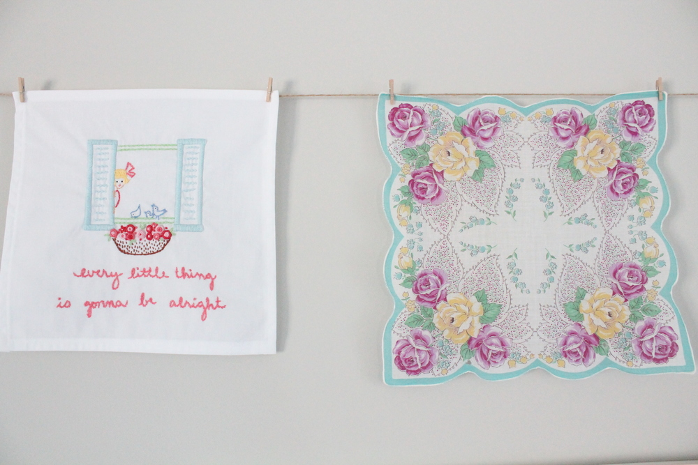 Simple decorating idea. Hang vintage handkerchiefs on a string with mini clothes pins.