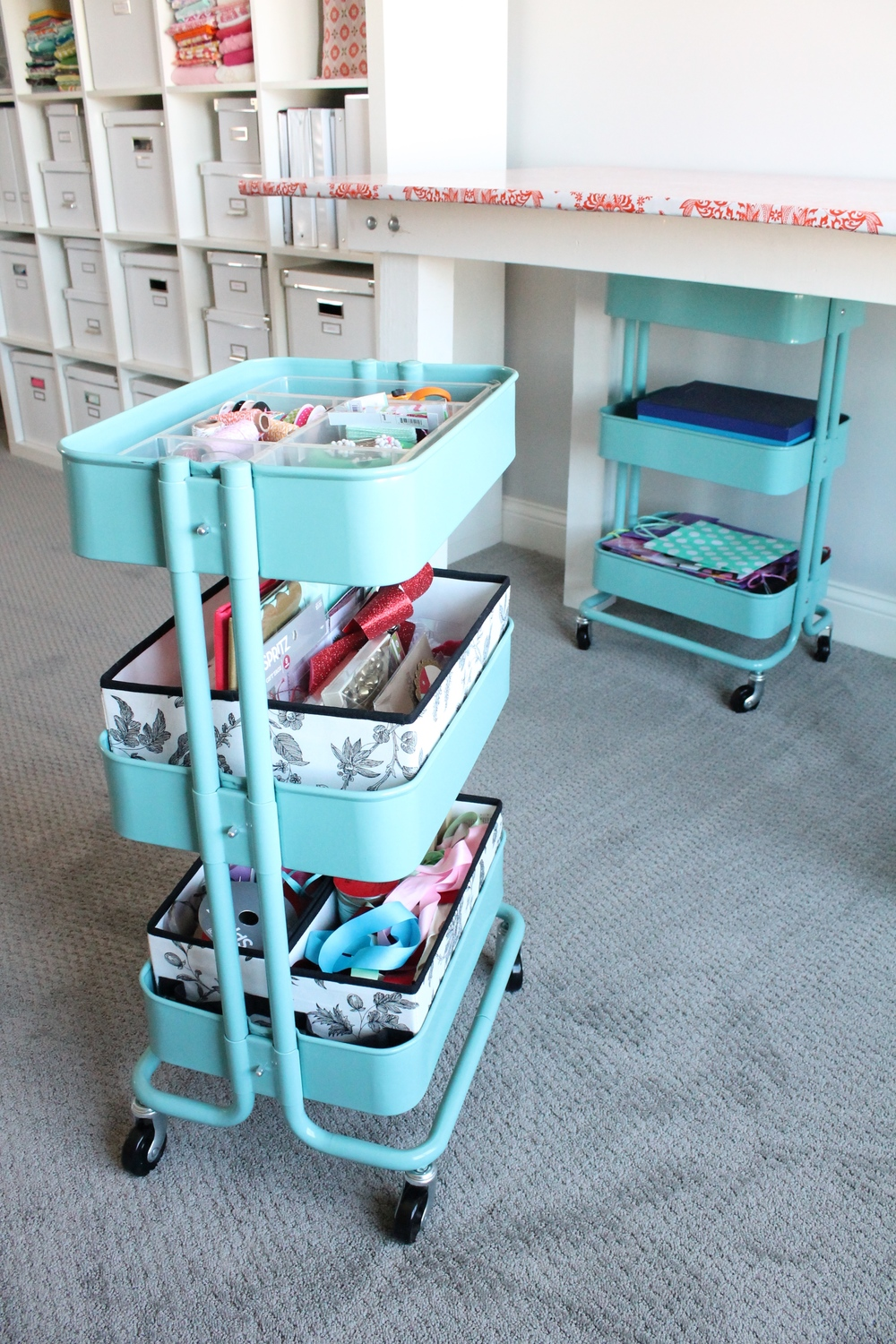 Aqua rolling carts from Ikea. Perfect place to organize supplies for the craft room.