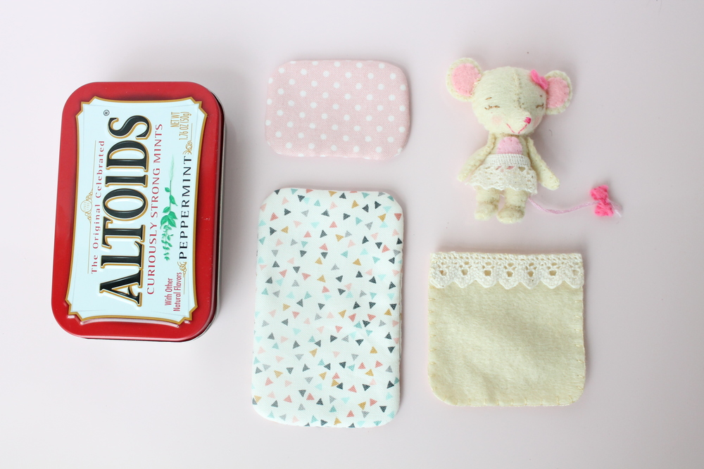 Little Mouse in a Tin. Hand sewn felt mouse with mattress pillow and blanket all inside a tin of Altoids.