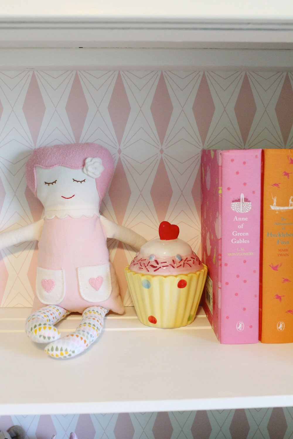 Black Apple Doll, Puffin Books and cupcake bank.