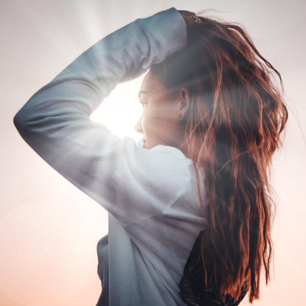 Woman & Light_Unsplash_Square.jpg
