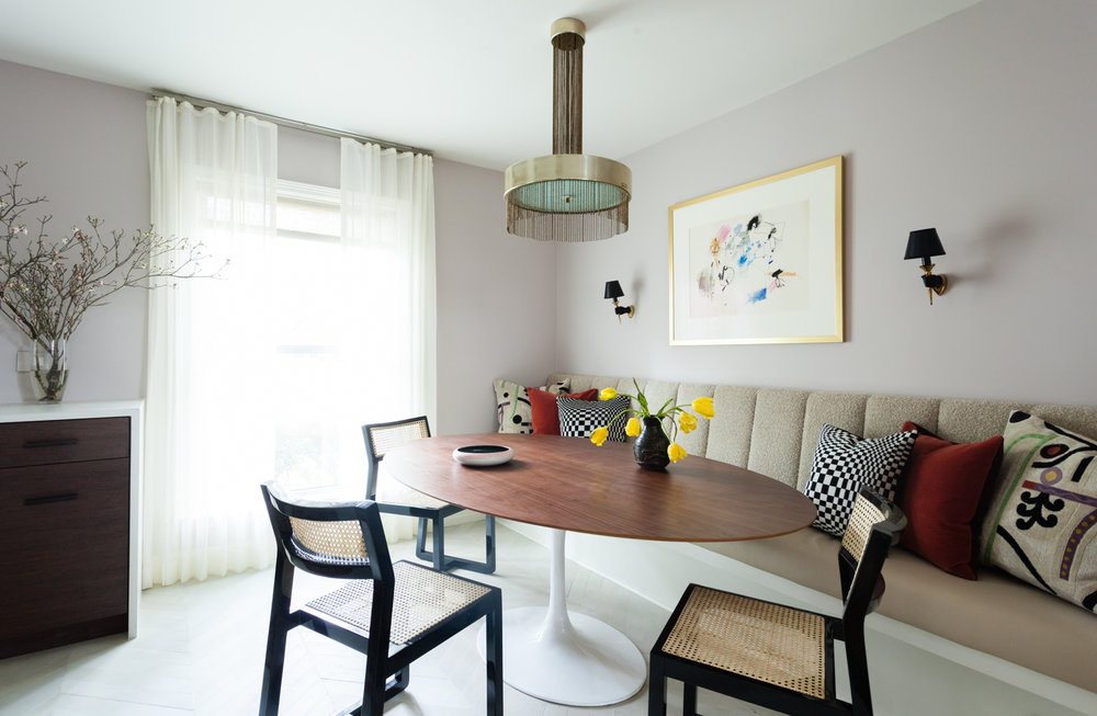 Built in banquette and vintage Pierre Cardin chandelier