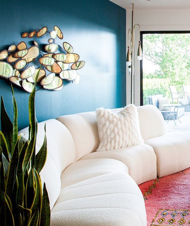 We finished this job years ago and it's still one of my favorites. Me and this crazy sofa were soul mates from day one, but it took some wrangling (and lots of fabric) to find her forever home 🌈 A solid plan is crucial but we always leave room for surprises ✨#projectmidmod . . . . . #erinwilliamsondesign #ilovemyjob #dscolor #colorlove #teal #bohostyle #bohodecor #moroccandecor #buyvintage #finditstyleit #currentdesignsituation #thisiswhyihavetothriftshopeveryday #homeenvy #design #designer #interiors123 #interiordesign #interiordesigner #austininteriordesign #atxdesign #jungalowstyle #eclecticdecor #interiorlovers #homerenovation #bohostyle #midmod #midcenturymodern #jere #brassforeva #whitedecor