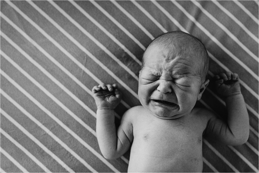 Baby boy crying on blanket during his first photo shoot | Orlando Fresh 48 Newborn Photographer