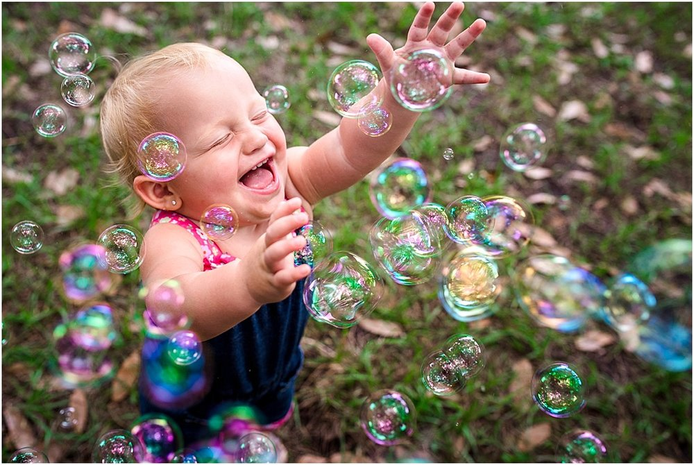 little girl in Winter Park chasing bubbles