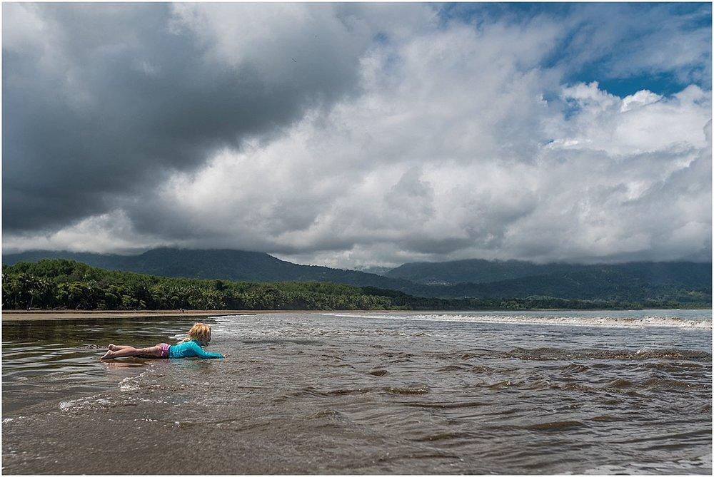 girl laying on the beach in Uvita, Costa Rica