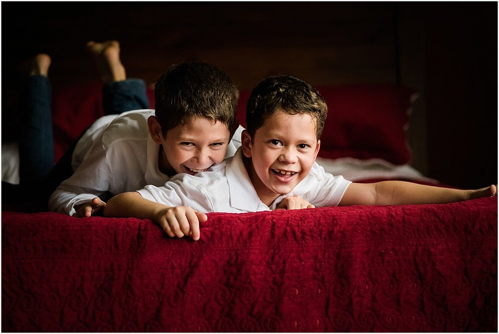 brothers giggling on bed in Costa Rica