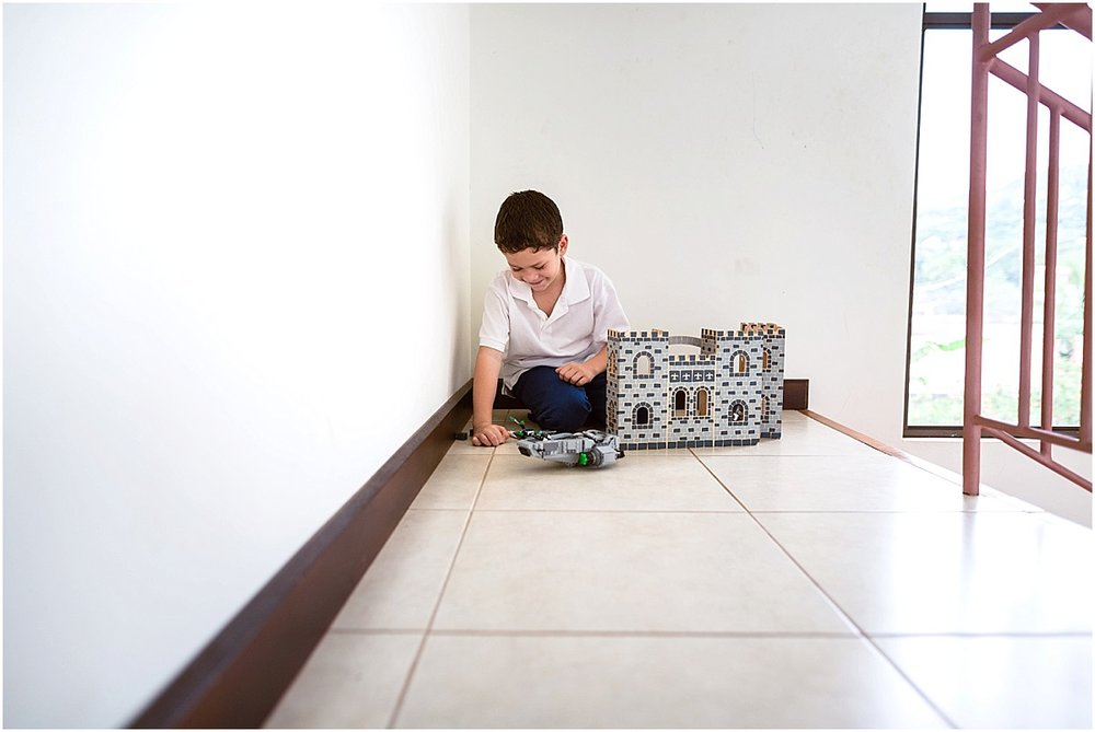 little boy playing with legos in his house in Costa Rica