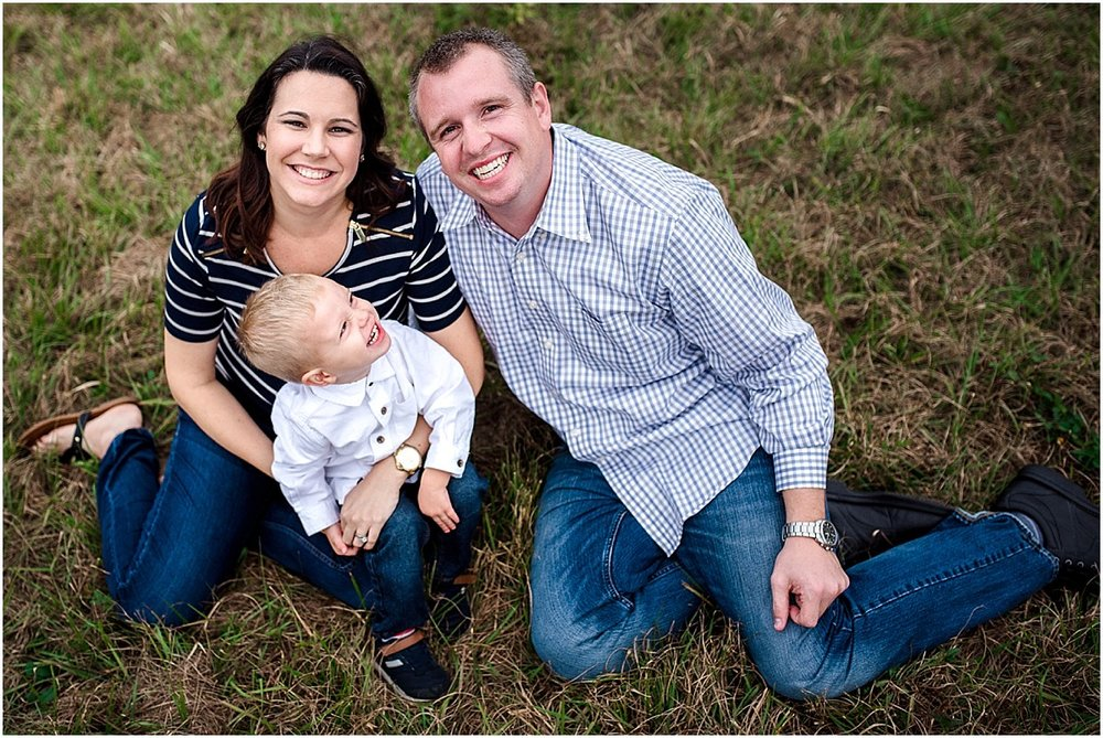family giggling in a field | Central Florida Lifestyle Family Photographer