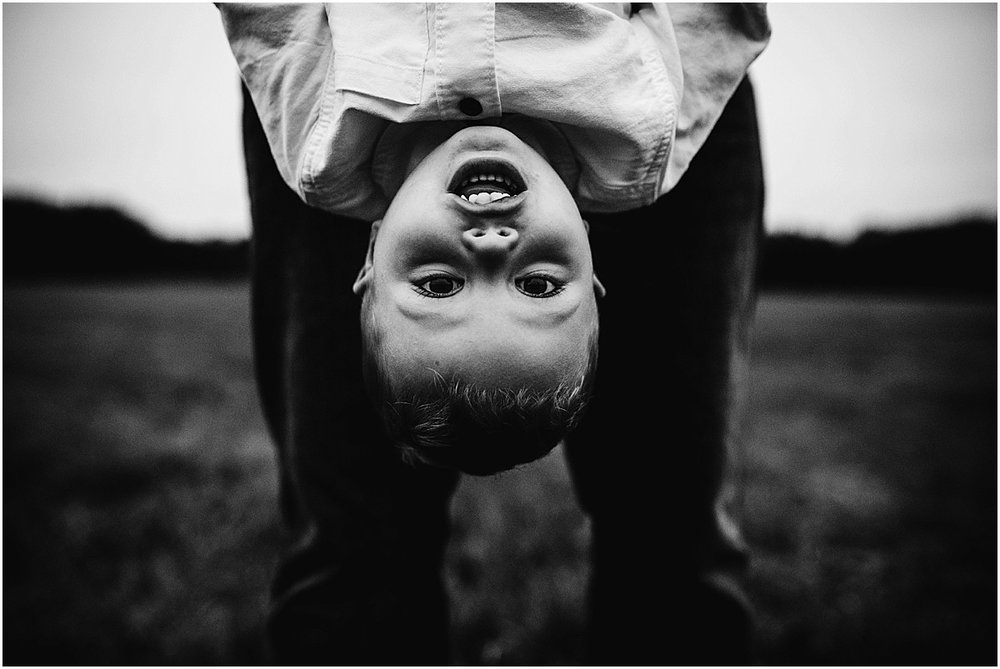 little boy hanging upside down  | Orlando Lifestyle Family Photographer