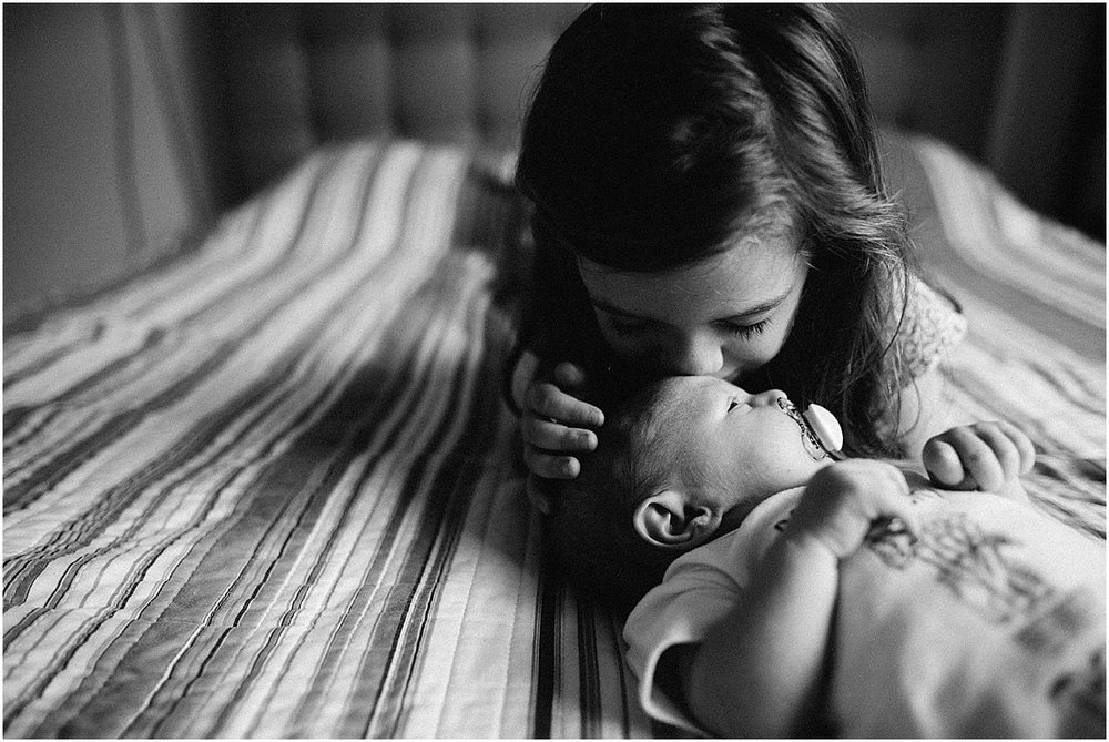 big sister kissing new baby brother  | Santa Ana, Costa Rica Lifestyle Photographer