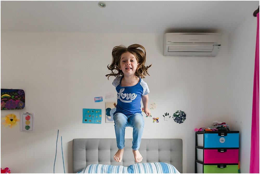 big sister jumping on the bed  | Santa Ana, Costa Rica Lifestyle Photographer