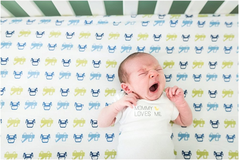 baby boy yawning in crib | Costa Rica Lifestyle Newborn Photographer