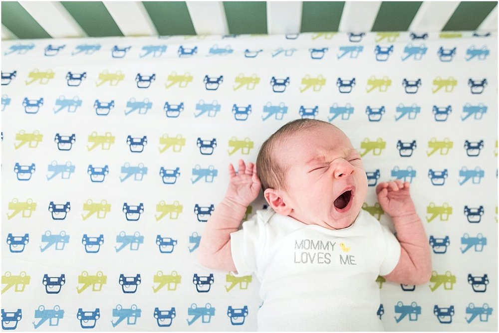 Newborn baby boy yawning | Orlando in-home newborn photography
