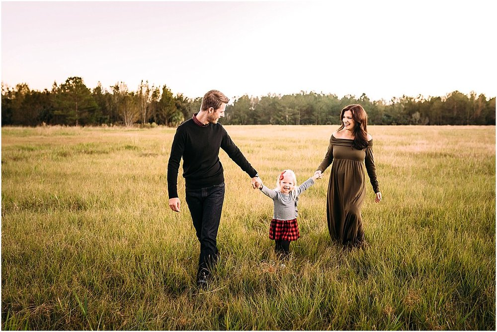 family walking in a field in Oviedo, Florida | Orlando Family Photography