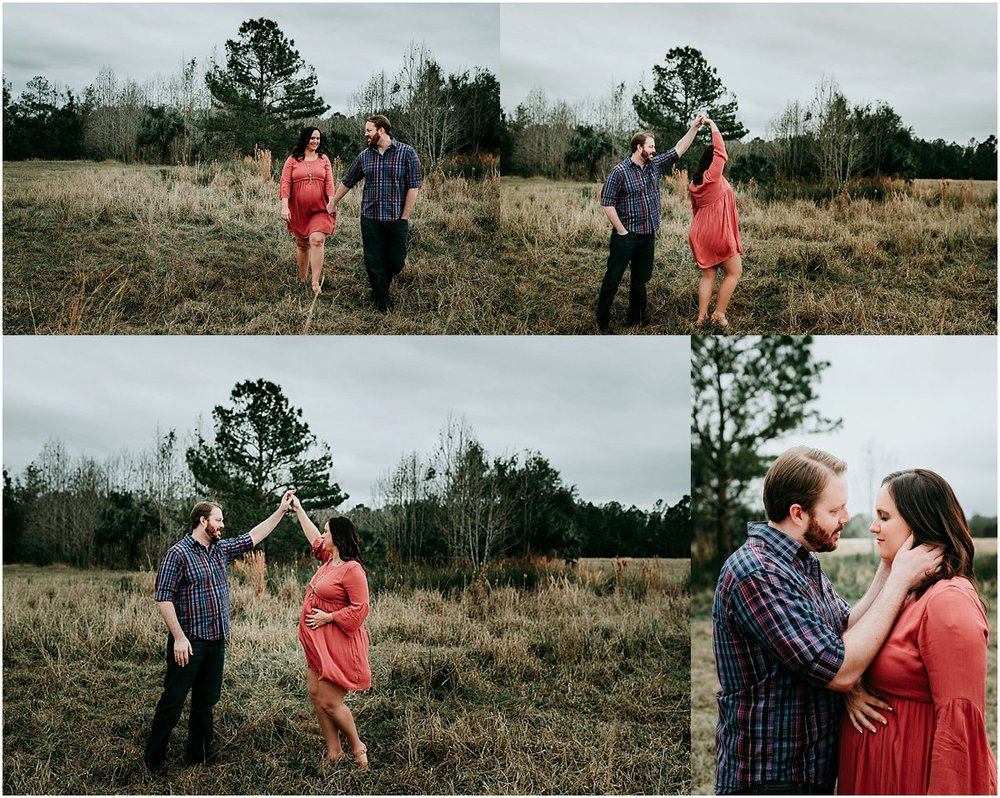 Soon-to-be parents dancing in a field during maternity photography | Orlando newborn photographer