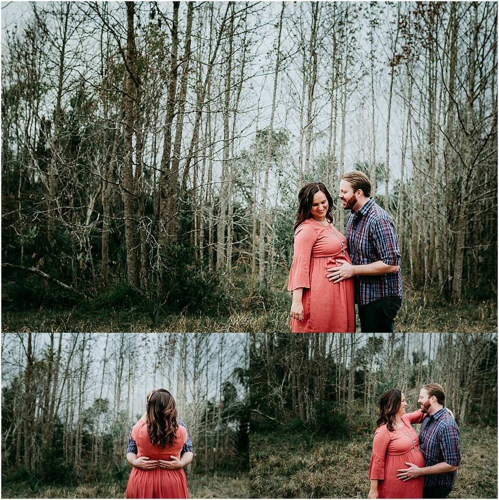 Dad touching mom's pregnant belly | Orlando maternity and newborn photographer