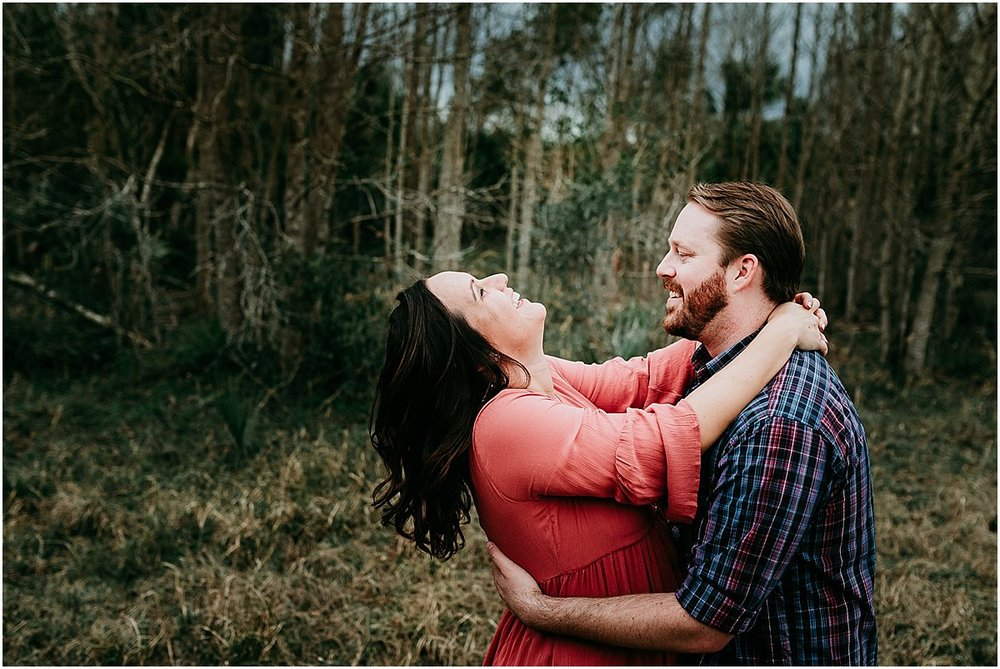 Expecting couple laughing during maternity photos | Orlando newborn photographer