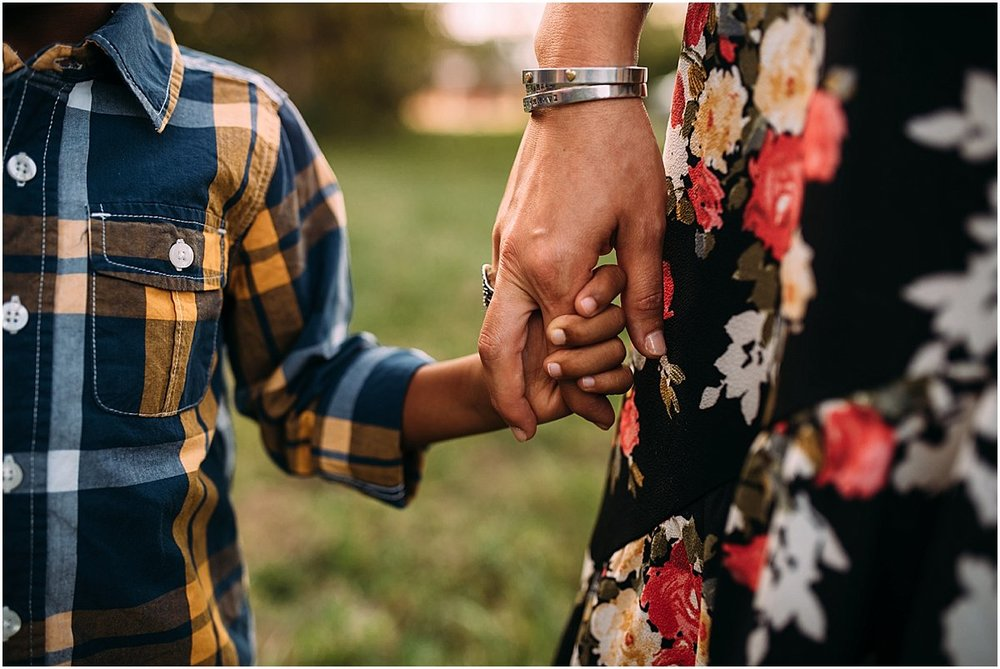 mom holding son's hand during family photos in Orlando, Florida