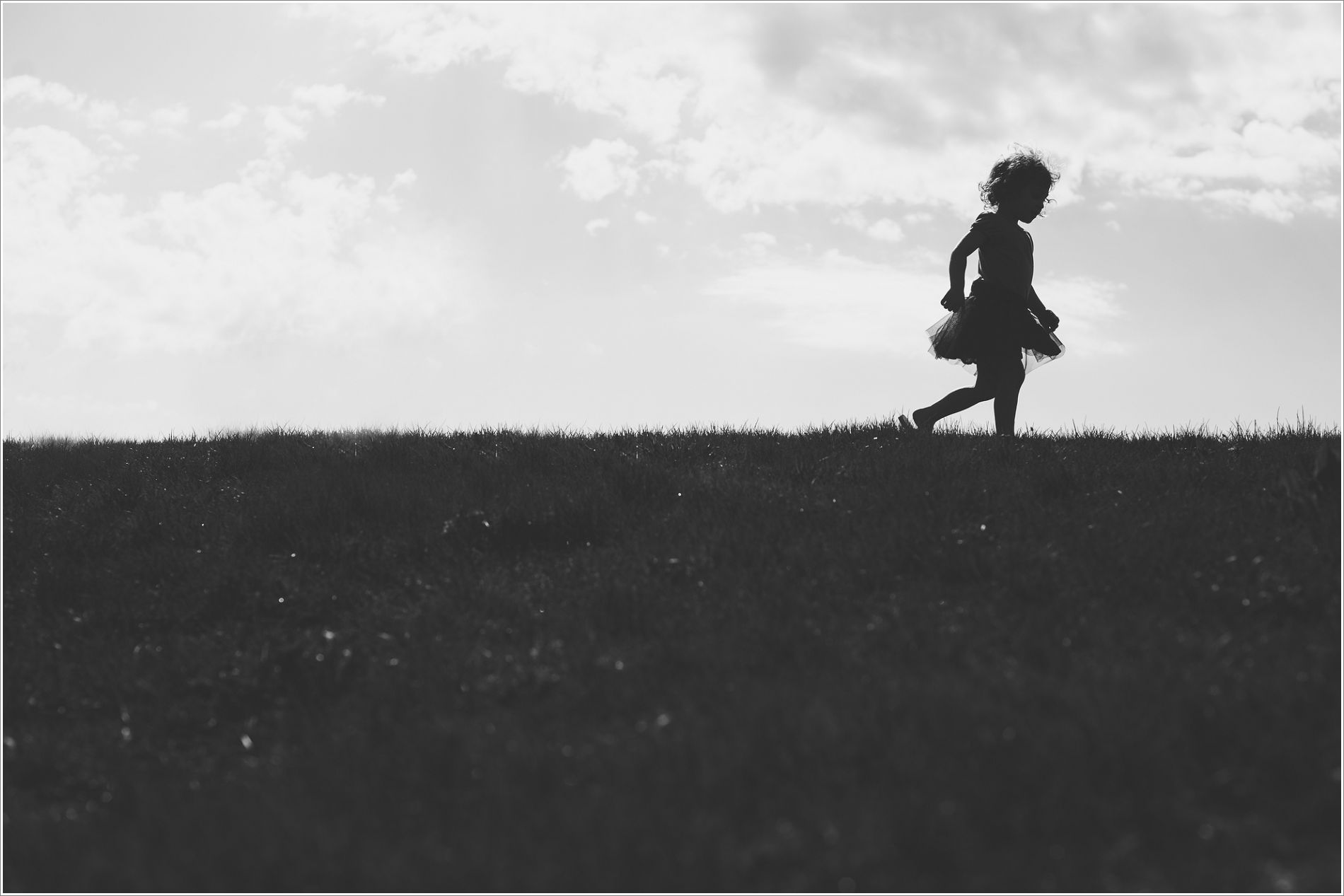 silhouette of girl on hill. verva photography