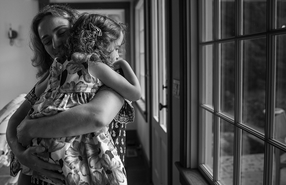 a mother's arms. documentary photography