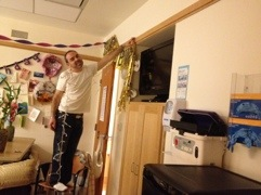 Brett taking down the decorations