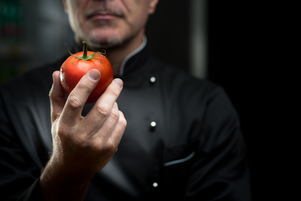 bigstock-Chef-Holding-A-Tomato-71901394.jpg