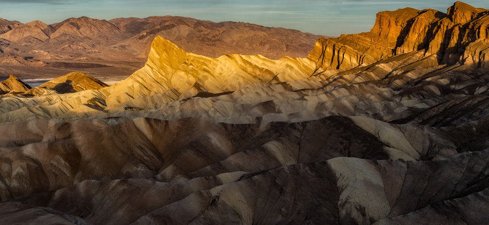 Sun Setting on Manly Beacon, Zabriskie Point, Death Valley NP, California
