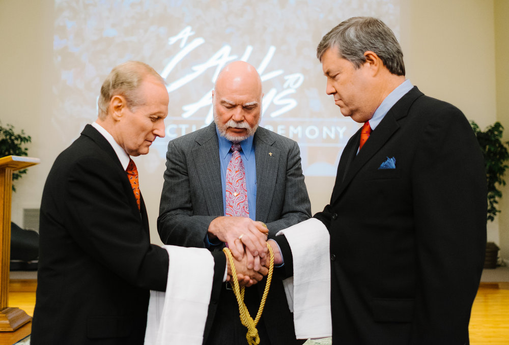 "At our ""A Call to Arms"" Induction Ceremony in January of 2016, President of Go To Nations, Dr. Jerry Williamson and Founder and CEO of GloDev, Tim Lovelace, publically demonstrated the covenant and functional partnership between Go To Nations and GloDev as sister 501(c)3 organizations, who are united in vision, complementary in purpose, identical in core values, and ""one"" in ministry fellowship. Dr. Grady Carter, Chairman of the Board for Go To Nations, officiated the ceremony and prayed the prayer of dedication and consecration.   Pictured above: Chairman of the Go To Nations Board of Directors, Dr. Grady Carter, President of Go To Nations, Dr. Jerry Williamson, and Founder and CEO of GloDev, Tim Lovelace."