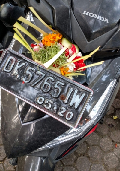 The motorbike I rode around for a month, adorned with an offering on my visit to the temple.  It fell off.