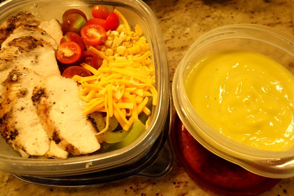 Grilled chicken salad, mango jalapeno dressing