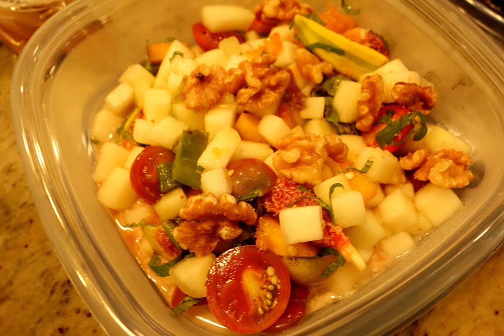 Fruit salad, walnuts, almond dressing