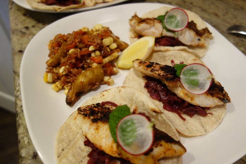 Blackened Red Snapper Tacos, Braised Red Cabbage, Pesto, Radish with a side of Spanish Rice, Fingerlings, Corn, Roasted Peppers