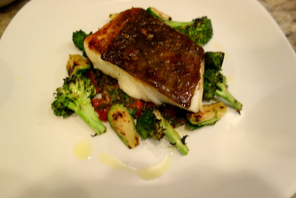 Seared Halibut, Broccoli, Brussels, Tomato and grilled green onion relish