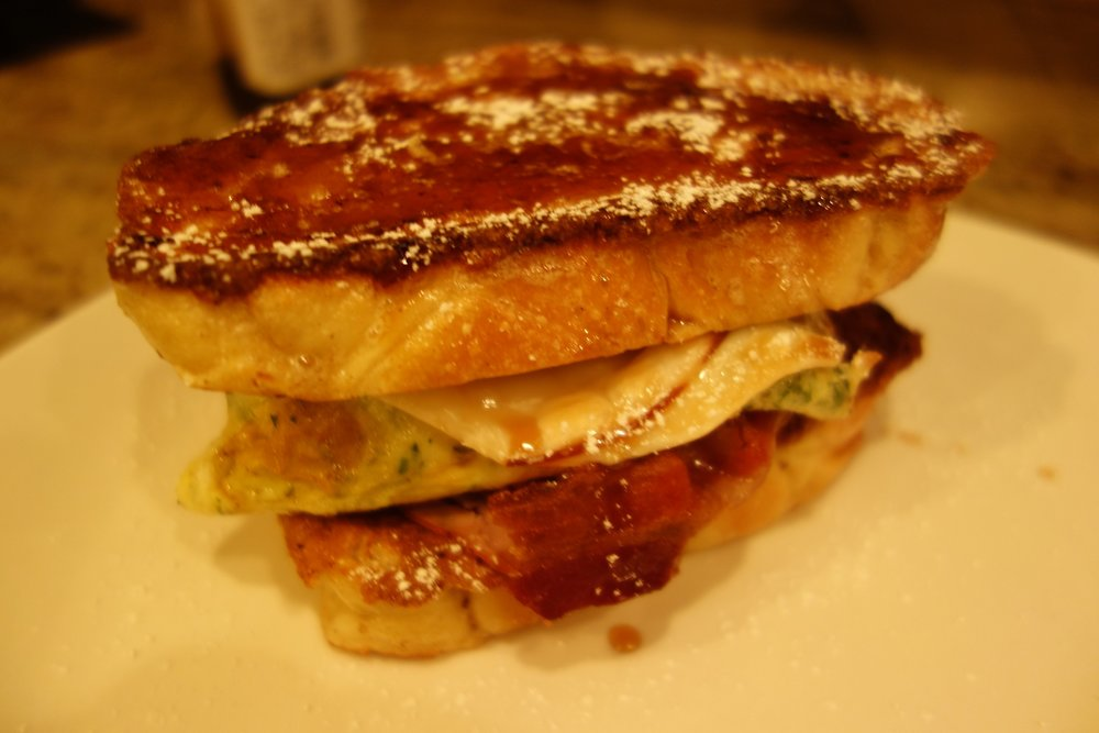 This must be one of my favorite creations to date: Challah French Toast breakfast sandwich, with bacon, egg, parsley, smoked goat gouda, blackforest ham, guajillo steeped maple syrup, confectioner's