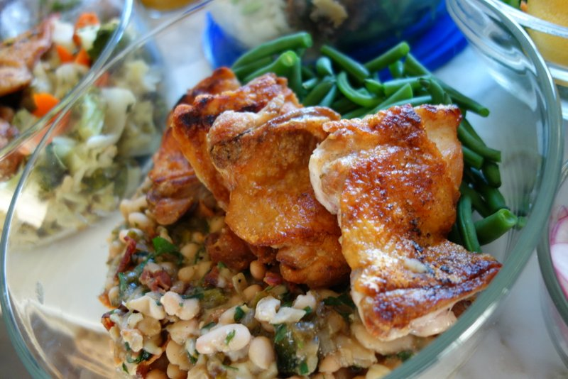 Pan-seared chicken thigh, green beans, white beans with bacon, poblano, and bacon