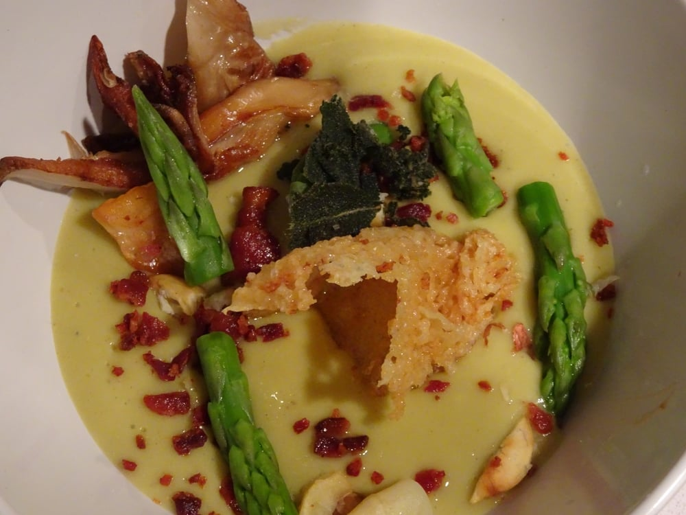 Asparagus and Smoked Cheddar Soup, Blanched Green and White Asparagus, Fried Sage, Crispy Bacon, Parmesan Tweel.