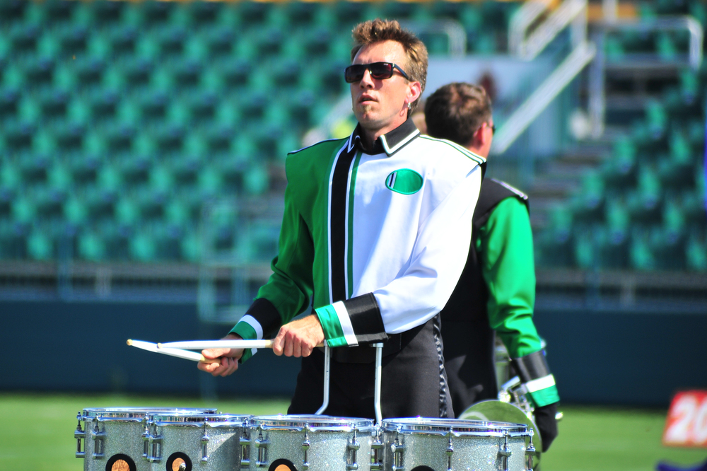 Member Justin of the Govenaires drumline performing during a drum feature section of the show at the Drum Corps Associates 2014 Championships   Photo provided by corpsreps.com   Full Resolution