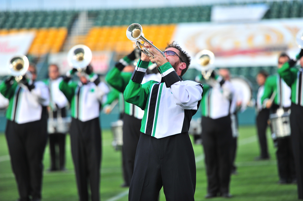 Govenaires Hornline member Aaron plays a high note during the opening impact of the show at the Drum Corps Associates 2014 Championships Photo provided by corpsreps.com Full Resolution