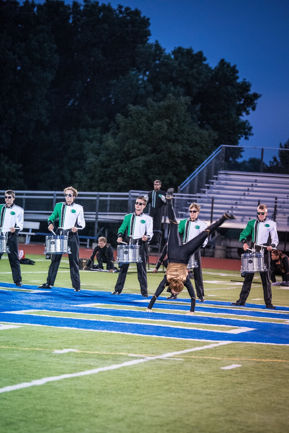 "Colorguard member Alex and members of the snareline perform a snare feature at the beginning of the closing segment of the 2015 production ""Outlaw"" at the Sounds of Minnesota show hosted at St. Thomas Academy in August.   Photo provided by TwinCitiesMedia.net   Full Resolution"