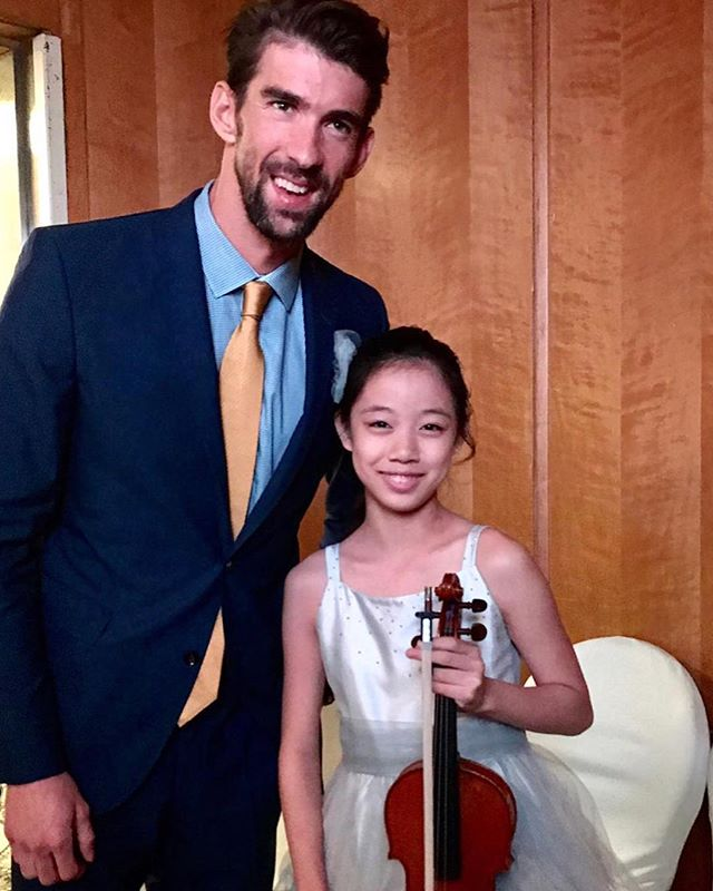 Madeline met Michael Phelps and was very inspired by his message for young achievers.  Whether it's violin or swimming, anything is possible with hard work and practice :) #wolfgangviolin #rolemodels #youngachievers #wvstrailblazerprogram #dreambigworkhard
