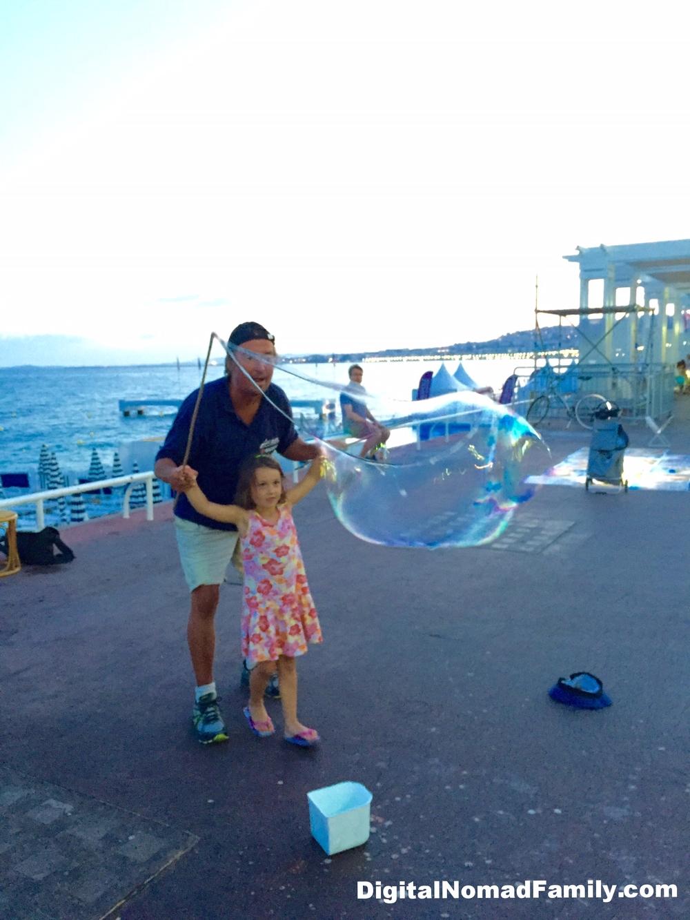 Juliet blowing bubbles on the Promenade des Anglais