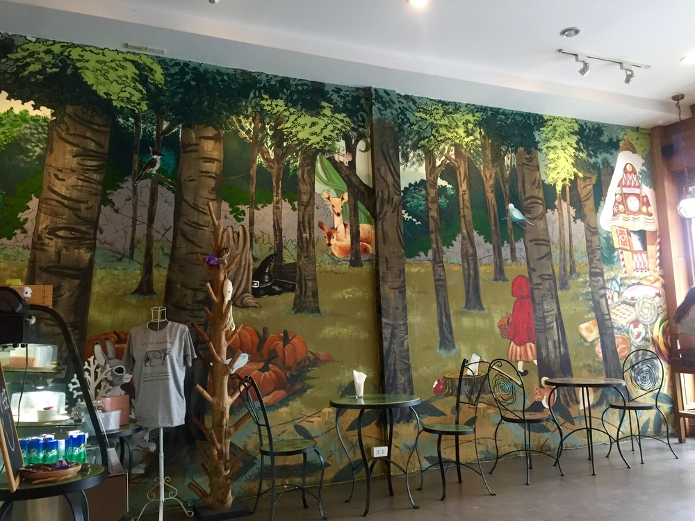 Fairy tale mural at Into The Woods coffee shop in Chiang Mai, Thailand