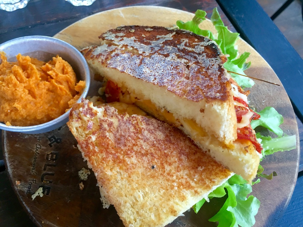 Rustic and Blue's grilled cheese, with a side of red pepper hummus