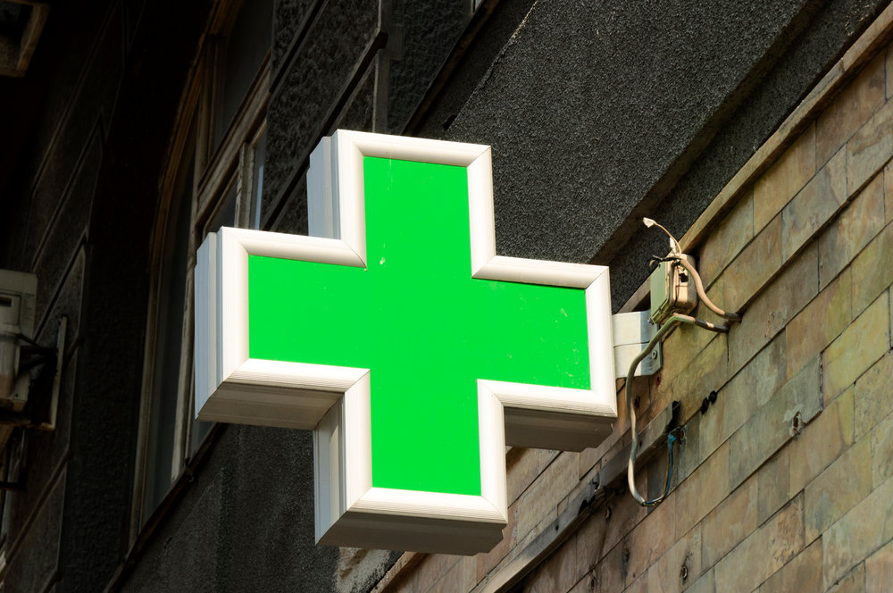 Typical green pharmacy sign you'll see when traveling abroad