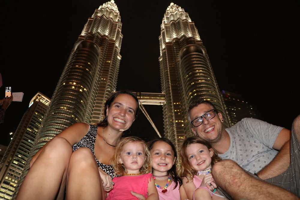Our family in front of Kuala Lumpur's iconic Petronas Towers