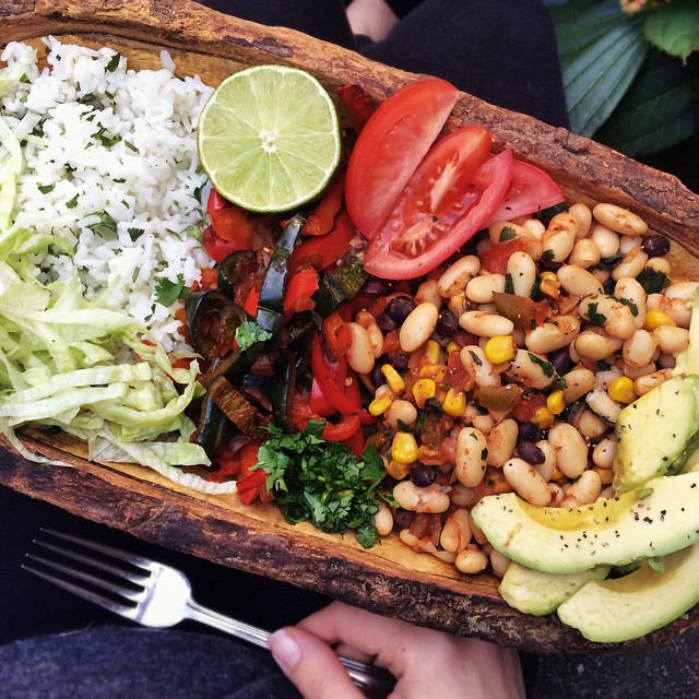 fitwithoutfat :   I'm eating this RIGHT NOW. Cilantro-lime rice (rice + cilantro + lime juice + cumin), fajitas (red bell pepper, poblano pepper, diced onion, chili powder, lime juice), cannellini beans (beans, corn, cilantro, diced tomato, salsa, cumin, chili powder, smoked paprika, lime juice). Served with lettuce and lime on the side, and of course, avocado. 😋